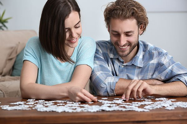 Couple working on a puzzle