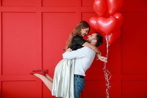 Couple with balloons